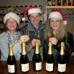 Ramazzotti staff in Santa hats with bottles